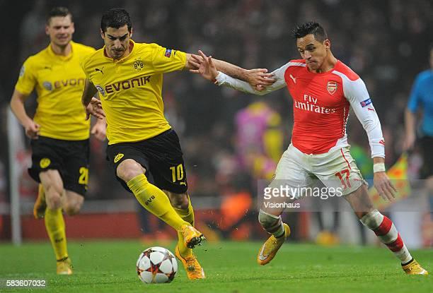 Alexis Sanchez of Arsenal and Henrikh Mkhitaryan of Borussia Dortmund during the UEFA Champions Group D match between Arsenal and Borussia Dortmund...