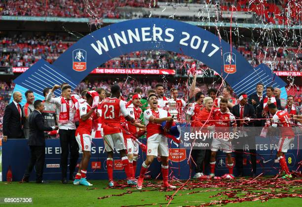 Alexis Sanchez of Arsenal and his Arsenal team mates celebrate with The FA Cup after The Emirates FA Cup Final between Arsenal and Chelsea at Wembley...
