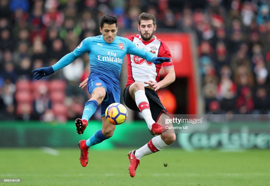 Alexis Sanchez of Arsenal and Jack Stephens of Southampton battle for the ball during the Premier League match between Southampton and Arsenal at St Mary's Stadium on December 10, 2017 in Southampton, England.