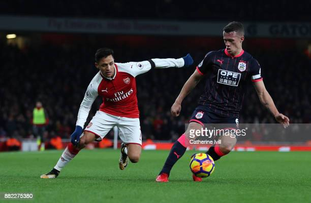 Alexis Sanchez of Arsenal and Jonathan Hogg of Huddersfield Town during the Premier League match between Arsenal and Huddersfield Town at Emirates...
