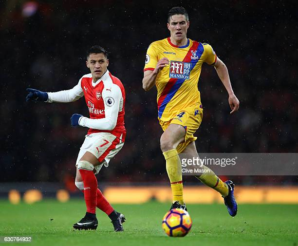 Alexis Sanchez of Arsenal and Martin Kelly of Crystal Palace compete for the ball during the Premier League match between Arsenal and Crystal Palace...