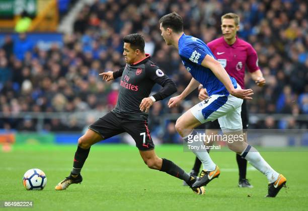 Alexis Sanchez of Arsenal and Michael Keane of Everton battle for possession during the Premier League match between Everton and Arsenal at Goodison...
