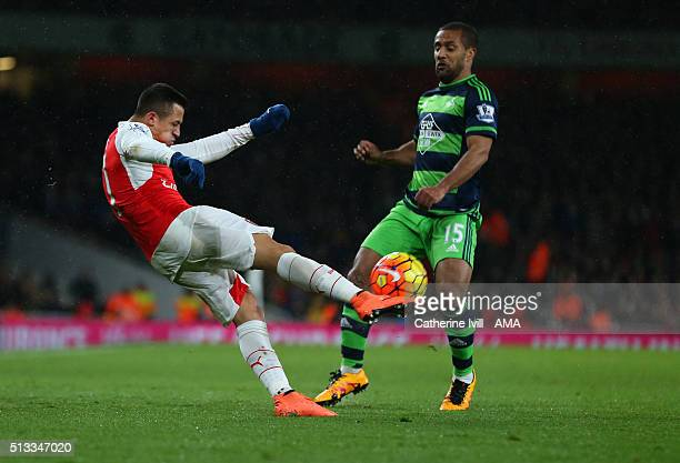 Alexis Sanchez of Arsenal and Wayne Routledge of Swansea City during the Barclays Premier League match between Arsenal and Swansea City at the...
