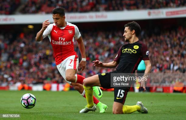 Alexis Sanchez of Arsenal attempts to get past Jesus Navas of Manchester City during the Premier League match between Arsenal and Manchester City at...