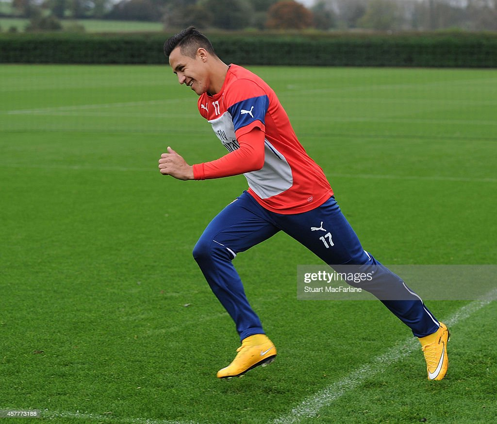 Alexis Sanchez of Arsenal attends a training session at London Colney on October 24, 2014 in St Albans, England.
