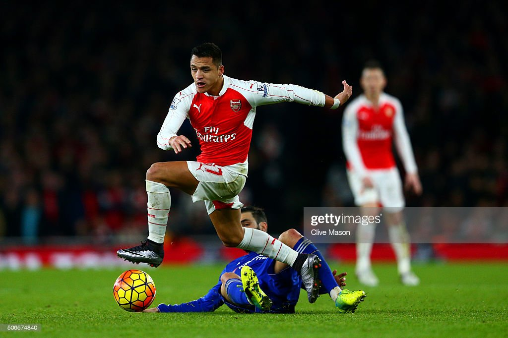 Alexis Sanchez of Arsenal battles for the ball with Cesc Fabregas of Chelsea during the Barclays Premier League match between Arsenal and Chelsea at Emirates Stadium on January 24, 2016 in London, England.