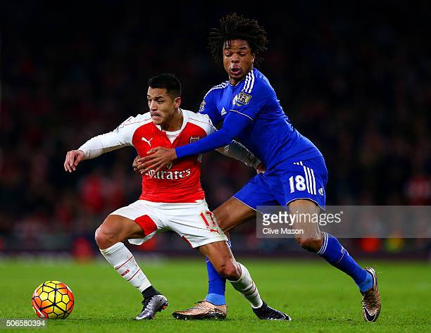 Alexis Sanchez of Arsenal battles for the ball with Loic Remy of Chelsea during the Barclays Premier League match between Arsenal and Chelsea at...