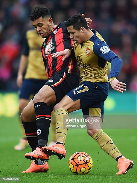 Alexis Sanchez of Arsenal battles with Joshua King of Bournemouth during the Barclays Premier League match between AFC Bournemouth and Arsenal at the...