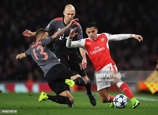 Alexis Sanchez of Arsenal battles with Rafinha and Arjen Robben of Bayern Muenchen during the UEFA Champions League Round of 16 second leg match...