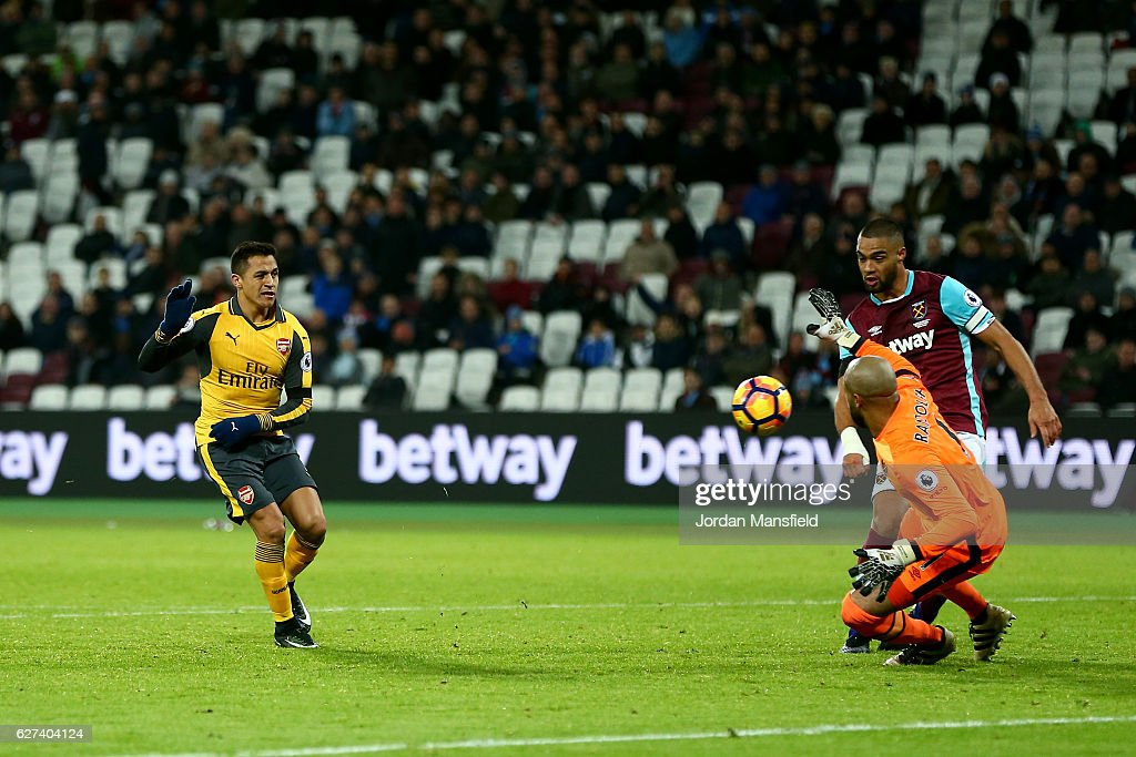 Alexis Sanchez of Arsenal beats goalkeeper Darren Randolph of West Ham United as he scores his team's fifth goal and completes his hat trick during the Premier League match between West Ham United and Arsenal at London Stadium on December 3, 2016 in London, England.