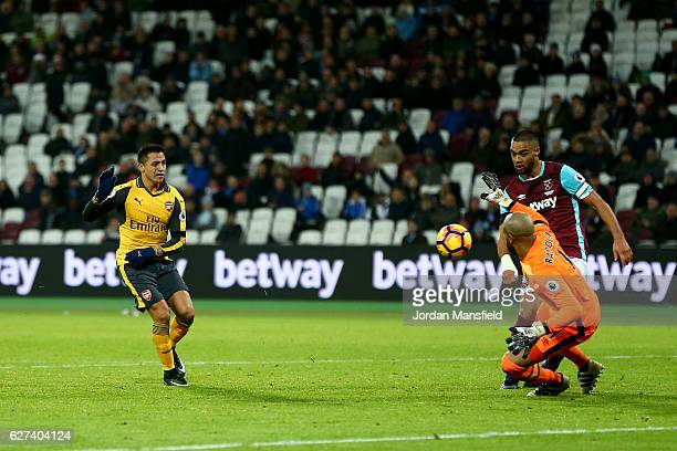 Alexis Sanchez of Arsenal beats goalkeeper Darren Randolph of West Ham United as he scores his team's fifth goal and completes his hat trick during...