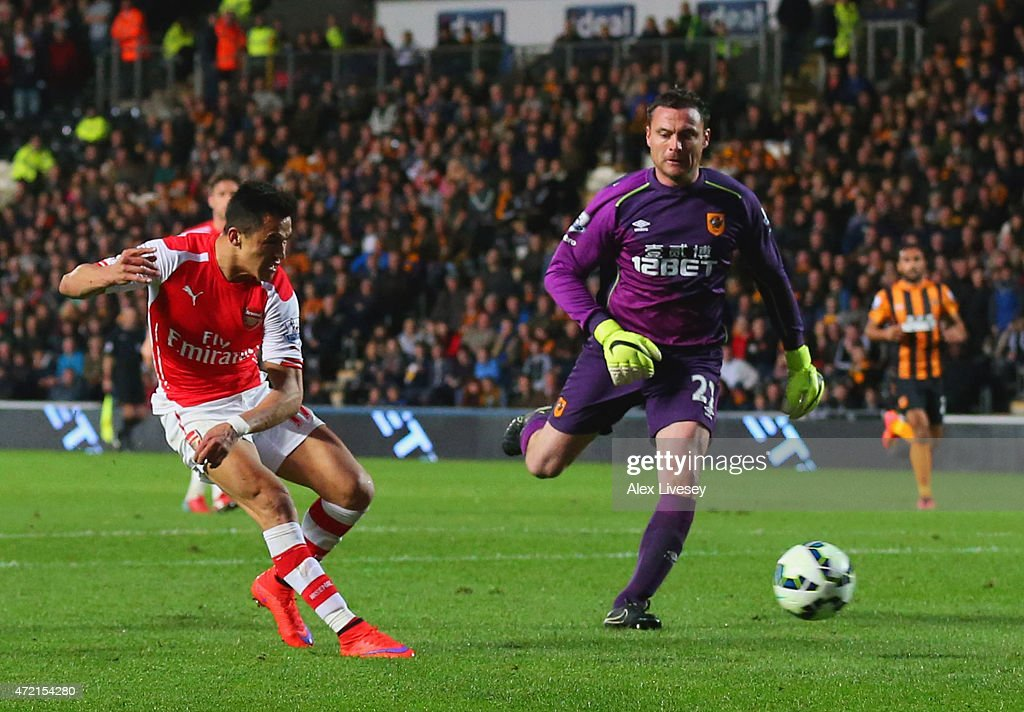 Alexis Sanchez of Arsenal (17) beats goalkeeper Steve Harper of Hull City as he scores their third goal during the Barclays Premier League match between Hull City and Arsenal at KC Stadium on May 4, 2015 in Hull, England.