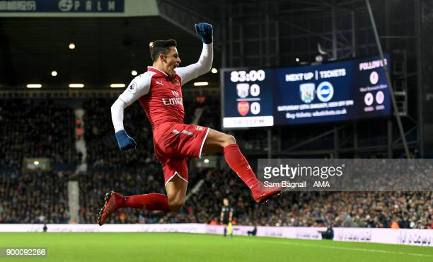 Alexis Sanchez of Arsenal celebrates after scoring a goal to make it 01 during the Premier League match between West Bromwich Albion and Arsenal at...