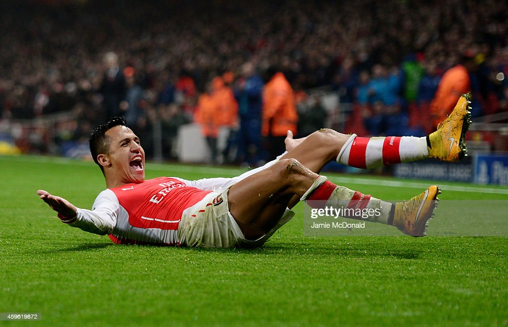 Alexis Sanchez of Arsenal celebrates after scoring his team's second goal during the UEFA Champions League Group D match between Arsenal and Borussia Dortmund at the Emirates Stadium on November 26, 2014 in London, United Kingdom.