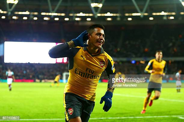 Alexis Sanchez of Arsenal celebrates after scoring his team's second goal during the Premier League match between West Ham United and Arsenal at...