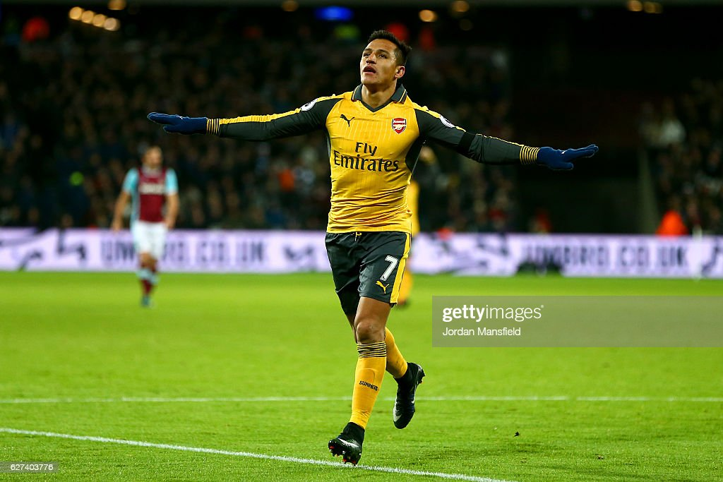 Alexis Sanchez of Arsenal celebrates after scoring his team's third goal during the Premier League match between West Ham United and Arsenal at London Stadium on December 3, 2016 in London, England.