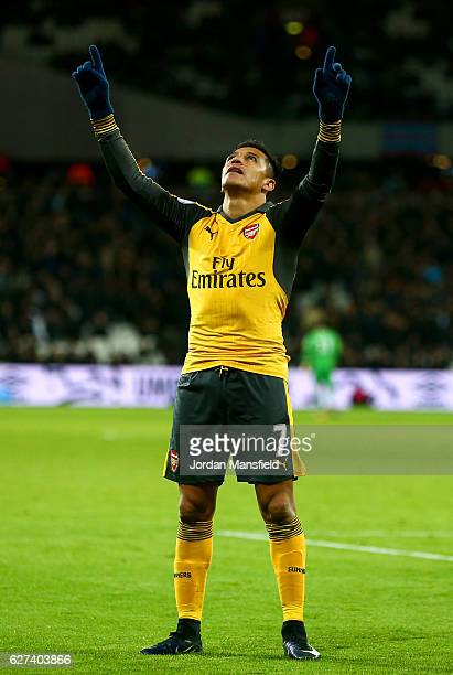 Alexis Sanchez of Arsenal celebrates after scoring his team's third goal during the Premier League match between West Ham United and Arsenal at...