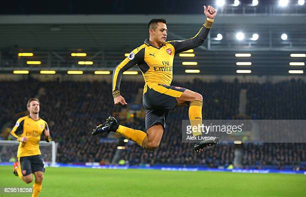 Alexis Sanchez of Arsenal celebrates after scoring the opening goal during the Premier League match between Everton and Arsenal at Goodison Park on...