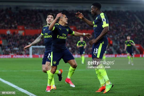 Alexis Sanchez of Arsenal celebrates after scoring to make it 01 with Danny Welbeck of Arsenal during the Premier League match between Southampton...