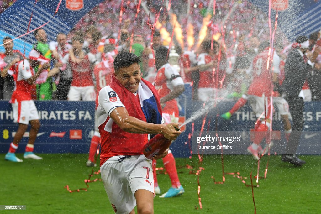 Alexis Sanchez of Arsenal celebrates after The Emirates FA Cup Final between Arsenal and Chelsea at Wembley Stadium on May 27, 2017 in London, England.