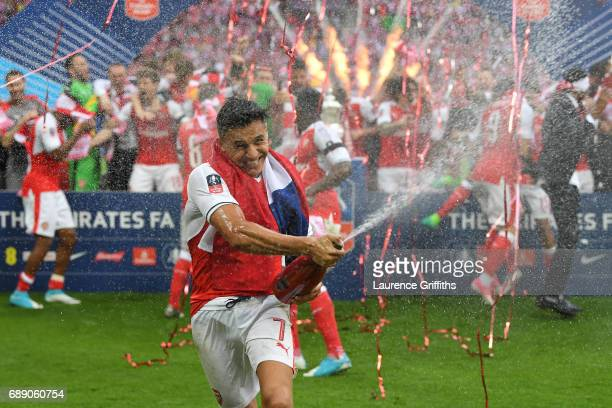 Alexis Sanchez of Arsenal celebrates after The Emirates FA Cup Final between Arsenal and Chelsea at Wembley Stadium on May 27 2017 in London England