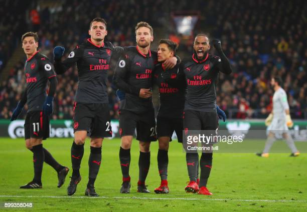 Alexis Sanchez of Arsenal celebrates as he scores their second goal with Mesut Ozil Granit Xhaka Shkodran Mustafi and Alexandre Lacazette during the...