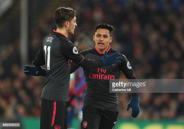 Alexis Sanchez of Arsenal celebrates as he scores their second goal with Mesut Ozil during the Premier League match between Crystal Palace and...