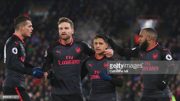 Alexis Sanchez of Arsenal celebrates as he scores their second goal with Granit Xhaka Shkodran Mustafi and Alexandre Lacazette during the Premier...