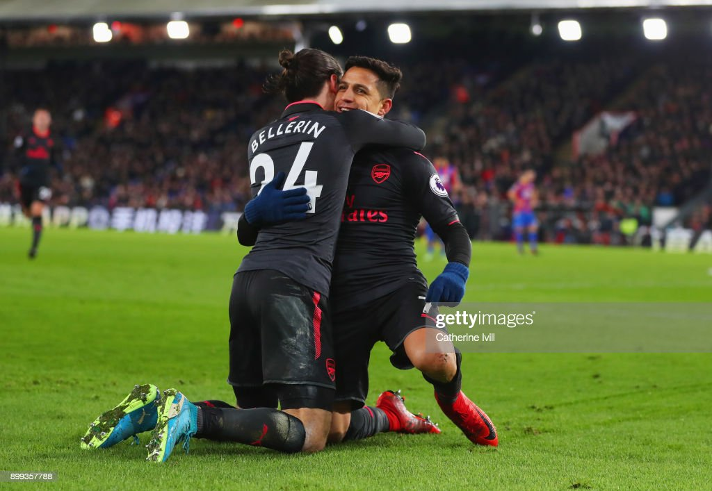 Alexis Sanchez of Arsenal celebrates as he scores their third goal with Hector Bellerin during the Premier League match between Crystal Palace and Arsenal at Selhurst Park on December 28, 2017 in London, England.