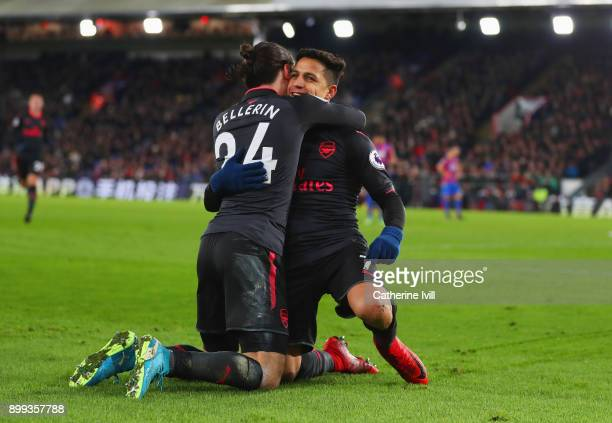 Alexis Sanchez of Arsenal celebrates as he scores their third goal with Hector Bellerin during the Premier League match between Crystal Palace and...