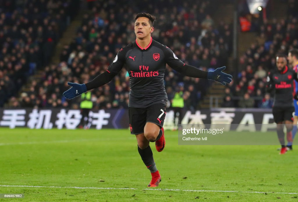 Alexis Sanchez of Arsenal celebrates as he scores their third goall during the Premier League match between Crystal Palace and Arsenal at Selhurst Park on December 28, 2017 in London, England.