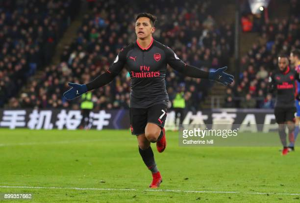 Alexis Sanchez of Arsenal celebrates as he scores their third goall during the Premier League match between Crystal Palace and Arsenal at Selhurst...