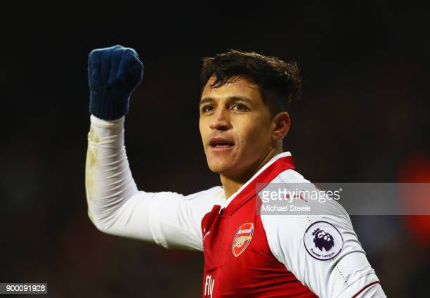 Alexis Sanchez of Arsenal celebrates as his free kick deflects off James McClean of West Bromwich Albion for their first goal during the Premier...
