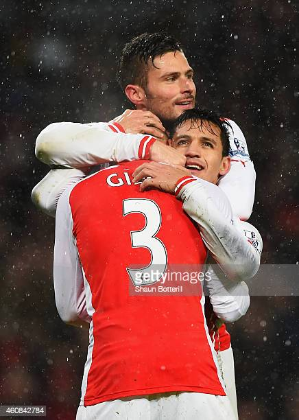 Alexis Sanchez of Arsenal celebrates his goal with Olivier Giroud and Kieran Gibbs during the Barclays Premier League match between Arsenal and...