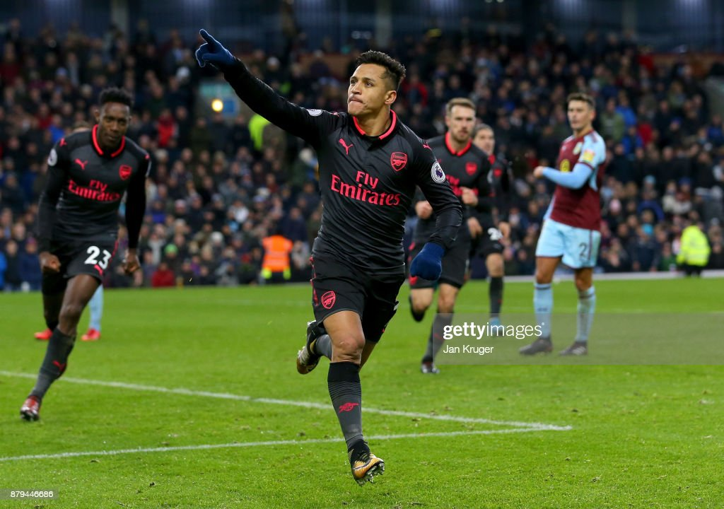 Alexis Sanchez of Arsenal celebrates scoiring the first goal during the Premier League match between Burnley and Arsenal at Turf Moor on November 26, 2017 in Burnley, England.