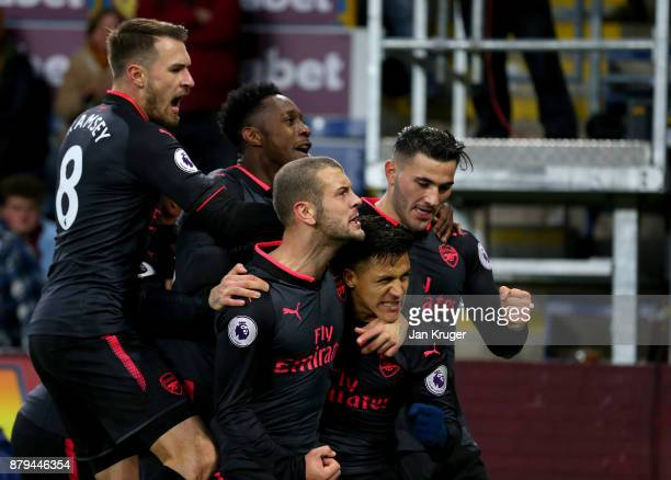 Alexis Sanchez of Arsenal celebrates scoiring the first goal with Aaron Ramsey Jack Wilshere Danny Welbeck and Sead Kolasinac of Arsenal during the...
