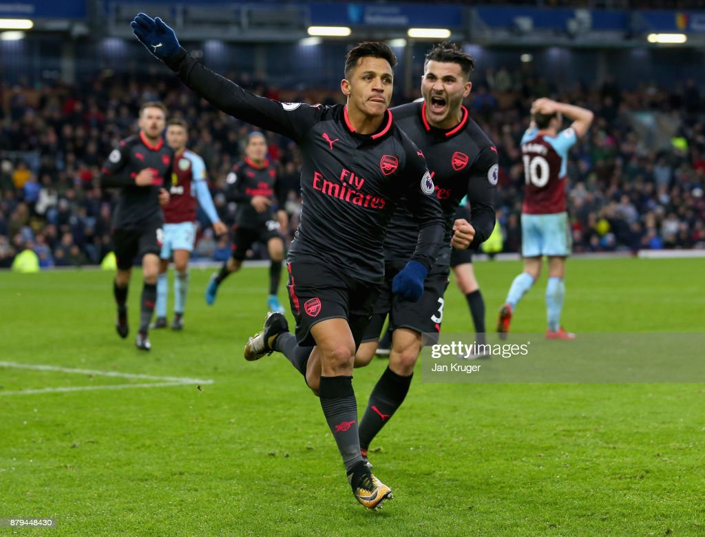 Alexis Sanchez of Arsenal celebrates scoiring the first goal with Sead Kolasinac of Arsenal during the Premier League match between Burnley and Arsenal at Turf Moor on November 26, 2017 in Burnley, England.