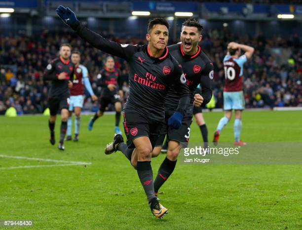 Alexis Sanchez of Arsenal celebrates scoiring the first goal with Sead Kolasinac of Arsenal during the Premier League match between Burnley and...