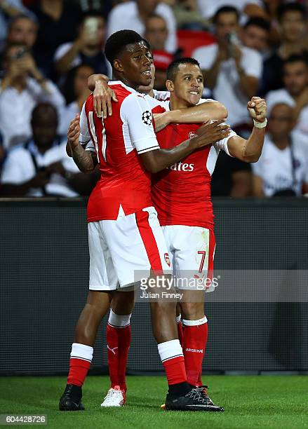 Alexis Sanchez of Arsenal celebrates scoring his sides first goal during the UEFA Champions League Group A match between Paris SaintGermain and...