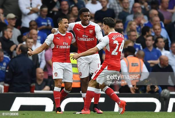Alexis Sanchez of Arsenal celebrates scoring his sides first goal with team mates Alex Iwobi of Arsenal and Hector Bellerin of Arsenal during the...