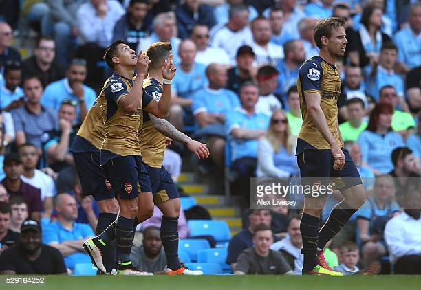 Alexis Sanchez of Arsenal celebrates scoring his side's second goal during the Barclays Premier League match between Manchester City and Arsenal at...