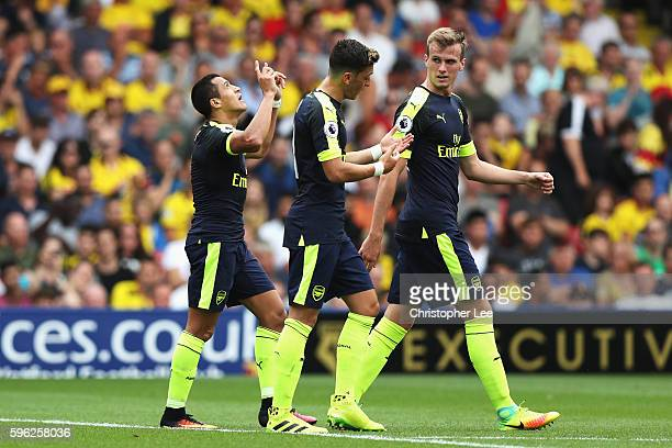 Alexis Sanchez of Arsenal celebrates scoring his sides second goal during the Premier League match between Watford and Arsenal at Vicarage Road on...