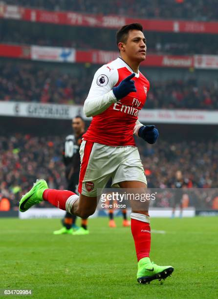 Alexis Sanchez of Arsenal celebrates scoring his side's second goal from the penalty spot during the Premier League match between Arsenal and Hull...