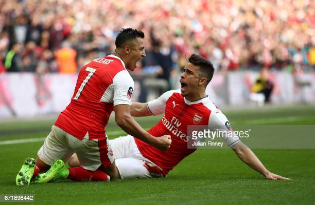 Alexis Sanchez of Arsenal celebrates scoring his side's second goal with his team mate Gabriel during the Emirates FA Cup SemiFinal match between...