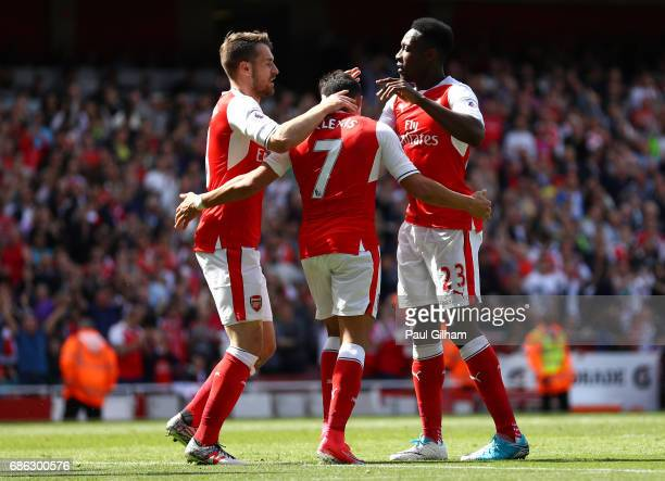 Alexis Sanchez of Arsenal celebrates scoring his sides second goal with Aaron Ramsey of Arsenal and Danny Welbeck of Arsenal during the Premier...