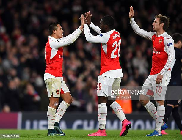 Alexis Sanchez of Arsenal celebrates scoring his side's third goal with Joel Campbell of Arsenal and Nacho Monreal of Arsenal during the UEFA...