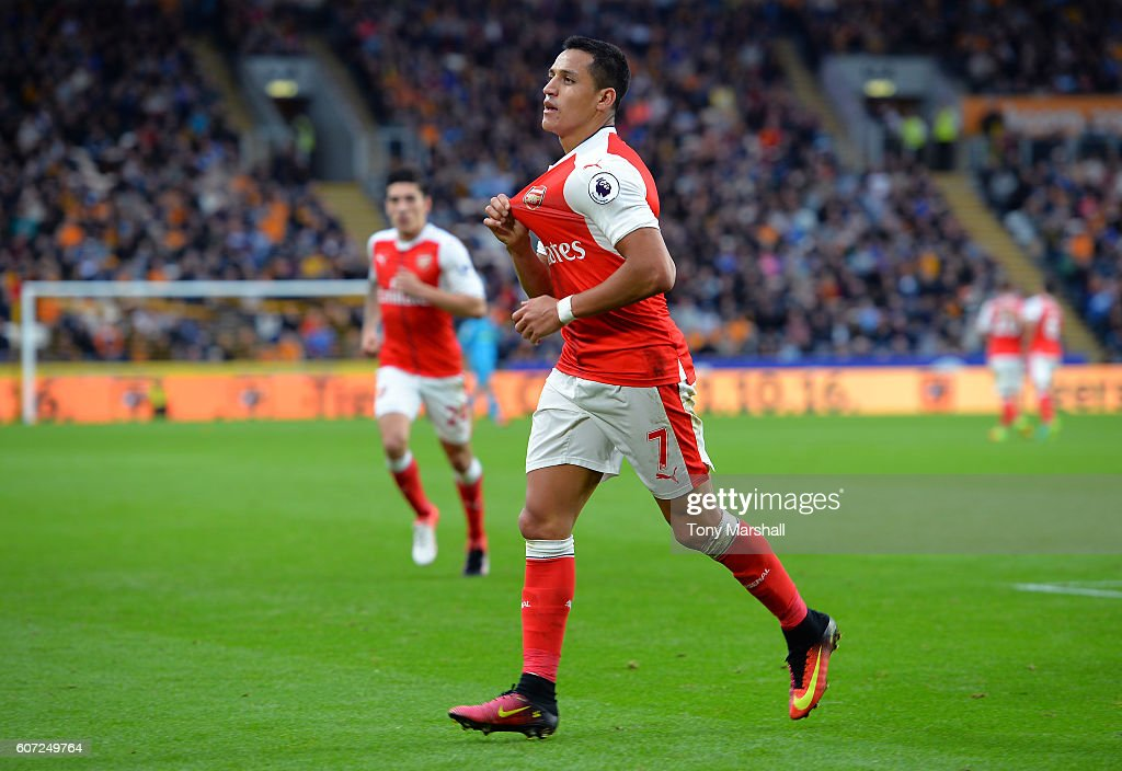 Alexis Sanchez of Arsenal celebrates scoring his sides third goal during the Premier League match between Hull City and Arsenal at KCOM Stadium on September 17, 2016 in Hull, England.