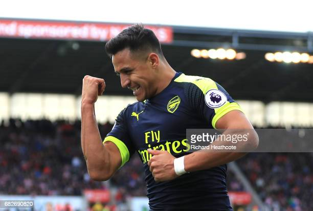 Alexis Sanchez of Arsenal celebrates scoring his sides third goal during the Premier League match between Stoke City and Arsenal at Bet365 Stadium on...