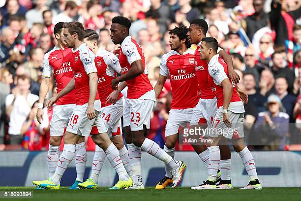 Alexis Sanchez of Arsenal celebrates scoring his team's first goal with his team mates during the Barclays Premier League match between Arsenal and...