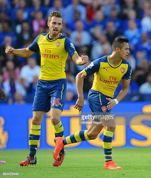 Alexis Sanchez of Arsenal celebrates scoring his team's opening goal with Aaron Ramsey during the Barclays Premier League match between Leicester...